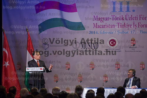 Abdullah Gul (R) president of Turkey and Viktor Orban (L) prime minister of Hungary talk during a business conference in Budapest, Hungary on February 17, 2014. ATTILA VOLGYI