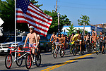 Don Bertelsmann of St. Louis leads the start of the11th Annual World Naked Bike Ride which was held Saturday in The Grove. He had his side-by-side tandem bike outfitted with a large American flag. Hundreds of participants wore nothing or next to nothing before, during and after the bicycle ride. There was also a costume contest, a drag show, music, food, vendor booths, and dancing.   Photo by Tim Vizer