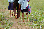 Barefoot Mayan children walk to school in southern Belize.