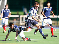 Mats Grambusch (L) of East Grinstead wins the ball from Kieran Roche during the England Hockey League Mens Premier Division game between Hampstead & Westminster against East Grinstead at The Paddington Recreation Ground, Maida Vale on Sun Oct 10, 2010