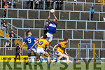Sean Sheehan Templenoe rises above Daniel O'Brien and Keran Murphy  during the Intermediate Championship semi final in Fitzgerald Stadium on Sunday