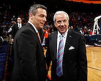 North Carolina head coach Roy Williams greets Virginia head coach Tony Bennett during the game at the John Paul Jones arena in Charlottesville, Va. Virginia defeated North Carolina 61-52.