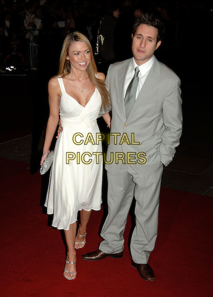 "ADELE SILVA & ANTONY COSTA.""Basic Instinct 2 "" world film premiere.vue cinema, Leicester Square.Leiceter Sqaure.London England 15th March 2006.Ref: PL.full length anthony white dress couple grey gray suit.www.capitalpictures.com.sales@capitalpictures.com.©Capital Pictures"