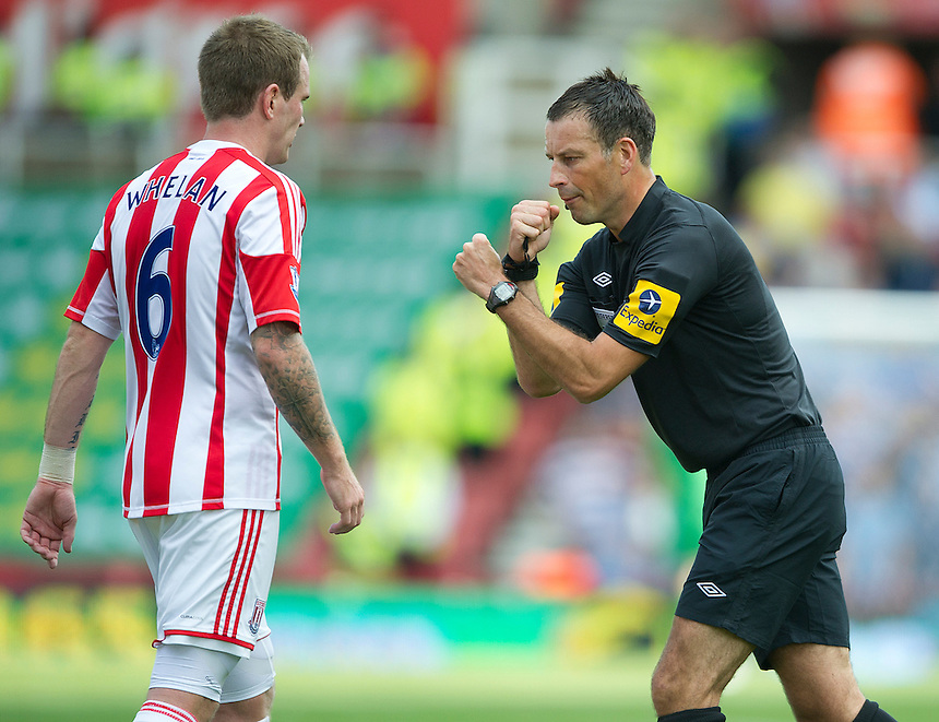 Referee Mark Clattenburg and Stoke City's Glenn Whelan play one potato two potato..Football - Barclays Premiership - Stoke City v Manchester City - Saturday 15th September 2012 - Britannia Stadium - Stoke..