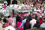 © Joel Goodman - 07973 332324 . 09/08/2013 . Salford , UK . A horse drawn cortege delivers the coffin to the church . The funeral of Linzi Ashton at St Paul's C of E Church in Salford , today (9th August 2013) . Linzi Ashton (25) was found murdered in her home on Westbourne Road in Salford on 29th June . Michael Cope is standing trial, accused of murdering, raping and assaulting her . Photo credit : Joel Goodman