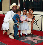 Actress Angela Bassett receives a star on the Hollywood Walk of Fame in Los Angeles, California on March 20, 2008. She poses with husband Courtney B Vance and their children Bronwyn Golden and Slater Josiah. Photopro.