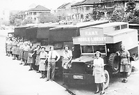 BNPS.co.uk (01202 558833)<br /> Pic: Pen&Sword/BNPS<br /> <br /> PICTURED: F.A.N.Y. mobile library, Hong Kong. Between 1945 and 1947, the Far East Welfare Unit had 400 Corps members.<br /> <br /> These inspiring photos of nurses on the front line feature in a new book which charts a century's heroic wartime service.<br /> <br /> The First Aid Nursing Yeomanry (FANY) was founded in 1907 by Captain Edward Baker with the early recruits trained in cavalry, signalling and camping.<br /> <br /> They were despatched to France at the outset for World War One to tend to injured troops on the battlefield, setting up hospitals for the many casualties. Other heroines dragged wounded personnel from exploding ammunition dumps.<br /> <br /> The brave nurses were again in the centre of the action in World War Two, performing sterling work in the harshest of conditions.<br /> <br /> Their stories feature in The First Aid Nursing Yeomanry in War and Peace, by Hugh Popham.