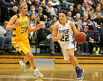 SIOUX FALLS, SD, FEBRUARY 10:  Mariah Szymanski #22 from the University of Sioux Falls drives against Logan O'Farrell #30 from Augustana Friday night at the Stewart Center in Sioux Falls. (Photo by Dave Eggen/Inertia)