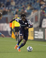 New England Revolution forward Kenny Mansally (7) dribbles down the wing. In a Major League Soccer (MLS) match, the New England Revolution defeated Sporting Kansas City, 3-2, at Gillette Stadium on April 23, 2011.