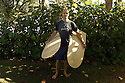 Hawaiian Mike Stewart with old replicas wooden boards on the Northshore of Hawaii.