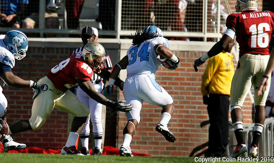 TALLAHASSEE, FL 11/6/10-FSU-NC FB10 CH-Florida State's Kendall Smith cant' stop North Carolina's Johnny White from scoring the Tar Heels  during first half action Saturday at Doak Campbell Stadium in Tallahassee. The Tar Heels beat the Seminoles 37-35. .COLIN HACKLEY PHOTO