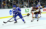 SIOUX FALLS, SD - MARCH 24: Zack Mirageas #74 from Air Force tries to control the puck in front of Riley Tufte #27 from Minnesota Duluth during their game at the 2018 West Region Men's NCAA DI Hockey Tournament at the Denny Sanford Premier Center in Sioux Falls, SD. (Photo by Dave Eggen/Inertia)