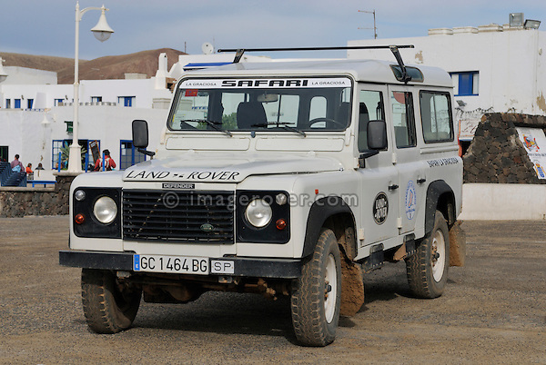 Spain, Canary Islands, Archipielago Chinijo, Isla Graciosa, Caleta del Sebo. Land Rover Defender 110 Station Wagon. --- No releases available. Automotive trademarks are the property of the trademark holder, authorization may be needed for some uses.