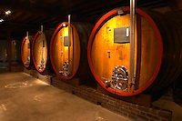 In the wine cellar: large oak storage casks, Champagne Jacquesson in Dizy, Vallee de la Marne, Champagne, Marne, Ardennes, France