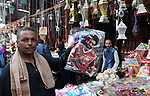 A picture taken on May 8, 2018 show an Egyptian man carries a pillow with a photo of Egyptian player Mohammed Salah at a market ahead of the holy Muslim month of Ramadan in Cairo, Egypt. Ramadan is sacred to Muslims because it is during that month that tradition says the Koran was revealed to the Prophet Mohammed. The fast is one of the five main religious obligations under Islam. Muslims around the world will mark the month, during which believers abstain from eating, drinking, smoking and having sex from dawn until sunset. Photo by Amr Sayed