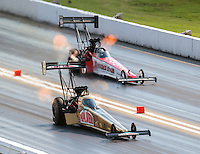 Sep 24, 2016; Madison, IL, USA; NHRA top fuel driver Leah Pritchett (near) races alongside Kyle Wurtzel during qualifying for the Midwest Nationals at Gateway Motorsports Park. Mandatory Credit: Mark J. Rebilas-USA TODAY Sports