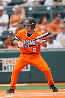 Oklahoma State Cowboys second baseman Tim Arakawa #2 squares to bunt during the NCAA baseball game against the Texas Longhorns on April 26, 2014 at UFCU Disch–Falk Field in Austin, Texas. The Cowboys defeated the Longhorns 2-1. (Andrew Woolley/Four Seam Images)