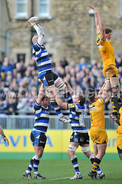 Matt Garvey rises high to win lineout ball. Aviva Premiership match, between Bath Rugby and London Wasps on February 22, 2014 at the Recreation Ground in Bath, England. Photo by: Patrick Khachfe / Onside Images