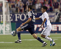 New England Revolution midfielder Monsef Zerka (19) controls the ball as San Jose Earthquakes midfielder Rafael Baca (30) pressures. In a Major League Soccer (MLS) match, the San Jose Earthquakes defeated the New England Revolution, 2-1, at Gillette Stadium on October 8, 2011.