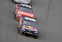 Feb 11, 2009; Daytona Beach, FL, USA; NASCAR Sprint Cup Series driver Brian Vickers (83) leads Tony Stewart (14) during race two of the Gatorade Duel at Daytona International Speedway. Mandatory Credit: Mark J. Rebilas-