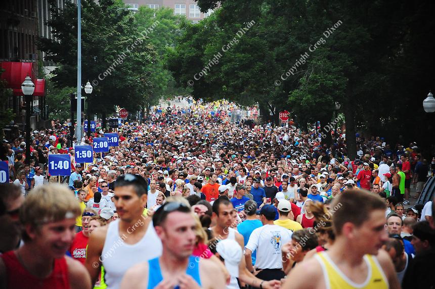 Runners fill Langdon Street at the start of the Madison Mini-Marathon on Saturday, 8/21/10, in Madison, Wisconsin