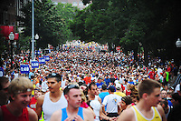 Runners fill Langdon Street at the start of the Madison Mini-Marathon on Saturday, 8/21/10, in Madison, Wisconsin