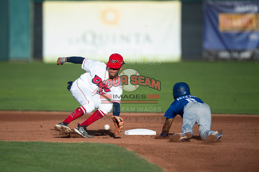 Orem Owlz shortstop Jeremiah Jackson (39) prepares to catch a throw from the catcher on a stolen base attempt as Jeremy Arocho (8) slides into second base during a Pioneer League game against the Ogden Raptors at Home of the OWLZ on August 24, 2018 in Orem, Utah. The Ogden Raptors defeated the Orem Owlz by a score of 13-5. (Zachary Lucy/Four Seam Images)