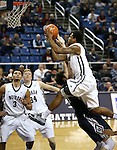 Nevada's AJ West (3) and Lucas Stivrins (34) watch Tyron Criswell (2) shoot over Utah State defender David Collette (13) during an NCAA college basketball game in Reno, Nev., on Tuesday, Jan. 20, 2015. Utah State won 70-54. (AP Photo/Cathleen Allison)