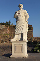 Modern statue of Aristotle, 384-322 BC, Greek philosopher, at the town entrance of Assos, Turkey. The city was founded from 1000 to 900 BC by Aeolian colonists from Lesbos. Aristotle (joined by Xenocrates) went to Assos, where he was welcomed by King Hermias, and opened an Academy in this city, where he led an influential group of philosophers. The statue is broken and the right hand is missing. Picture by Manuel Cohen