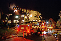 Hydraulic platform attending a house fire...© SHOUT. THIS PICTURE MUST ONLY BE USED TO ILLUSTRATE THE EMERGENCY SERVICES IN A POSITIVE MANNER. CONTACT JOHN CALLAN. Exact date unknown.john@shoutpictures.com.www.shoutpictures.com. ... ..