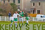 Martin Moriarty Castleisland and Gene Lett Killybegs challenge for the ball n their FAI Junior cup clash in Killybegs on Sunday