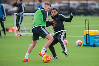 Wednesday  06 January 2016<br /> Pictured L-R: Adam King and Jefferson Montero of Swansea in action during training<br /> Re: Swansea City Training session at the Fairwood training ground, Swansea, Wales, UK