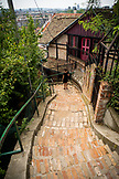 SERBIA, Belgrade, A woman walks down a staircase in the Zemun neighborhood, Eastern Europe