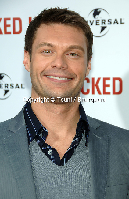 Ryan Seacrest arriving at KNOCKED UP Premire at the Westwood Village Theatre In Los Angeles. <br /> <br /> headshot<br /> eye contact<br /> smile