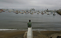 LOS ANGELES,CA - MAY 2,2009:  Odette Lackey had planned on being in Ensenada, Mexico today. Her cruise ship was rerouted to Catalina Island, she spends some time enjoying the harbor view in Avalon, May 2, 2009.  Many cruise ships are rerouting from destinations in flu-plagued Mexico to Catalina Island, Avalon. Merchants are scrambling to accommodate at least 45,000 this month, up from the usual 15,000 in May.