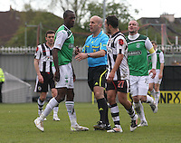 Referee Stephen Finnie intervenes between Isaiah Osbourne (left) and Dougie Imrie in the St Mirren v Hibernian Clydesdale Bank Scottish Premier League match played at St Mirren Park, Paisley on 29.4.12.