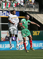 David Solorzano (20) goes up for the header against Gerardo Torrado (6). Mexico defeated Nicaragua 2-0 during the First Round of the 2009 CONCACAF Gold Cup at the Oakland Coliseum in Oakland, California on July 5, 2009.