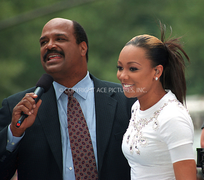 New singer MONICA performs at CBS Early Show in New York. July 30, 2002. Monica is pictured with TV host Mark McEwen. REF: AMUS2099. Please byline: Anthony Moore/NY Photo Press.   ..*PAY-PER-USE*      ....NY Photo Press:  ..phone (646) 267-6913;   ..e-mail: info@nyphotopress.com