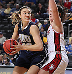 SIOUX FALLS, SD - MARCH 7:  Blair Bryce #30 of Oral Roberts looks for a shot against defender Kate Liveringhouse #34 of South Dakota (Photo by Dick Carlson/Inertia)