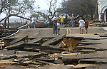 Residents overlook Beach Blvd. along the Gulf of Mexico after Hurricane Katrina passed on Monday, August 29, 2005 in Bay St. Louis, Mississippi.