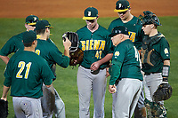 Siena Saints head coach Tony Rossi (40) pulls starting pitcher Tom Miller (42) for relief pitcher John Nolan (21) as third baseman Jordan Folgers (12), shortstop Tyler Martis (hidden), second baseman Jordan Bishop (back), first baseman Joe Drpich (47), and catcher Phil Madonna (3) during a game against the Stetson Hatters on February 23, 2016 at Melching Field at Conrad Park in DeLand, Florida.  Stetson defeated Siena 5-3.  (Mike Janes/Four Seam Images)