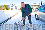 91 year old John Coffey shovels snow from outside his house on Lewis Road, Killarney on Saturday morning.