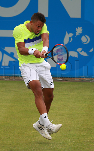June 12th 2017,  Nottingham, England; WTA Aegon Nottingham Open Tennis Tournament day 3; 18 yr old Jay Clarke of Great Britaingets airborne hitting a backhand in his match against Yuki Bhambri of India