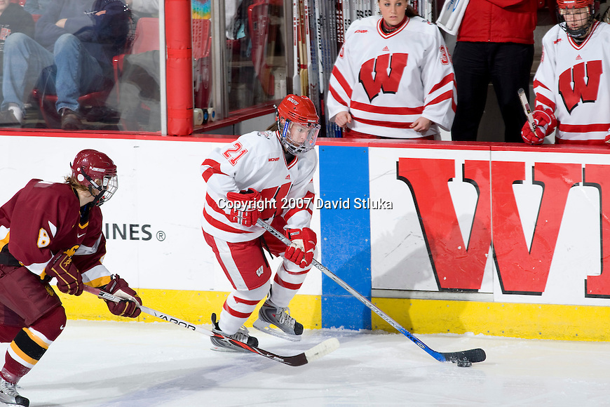 MADISON, WI - DECEMBER 1: Angie Keseley #21 of the Wisconsin Badgers women's hockey team handles the puck against the Minnesota Duluth Bulldogs at the Kohl Center on December 1, 2007, in Madison, Wisconsin. The Bulldogs beat the Badgers 3-2. (Photo by David Stluka)