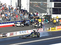 Feb 11, 2018; Pomona, CA, USA; NHRA top fuel driver Brittany Force smokes the tires prior to crashing during round one of the Winternationals at Auto Club Raceway. Mandatory Credit: Mark J. Rebilas-USA TODAY Sports