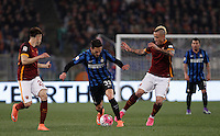 Calcio, Serie A: Roma vs Inter. Roma, stadio Olimpico, 19 marzo 2016.<br /> FC Inter&rsquo;s Danilo D'Ambrosio, center, is challenged by Stephan El Shaarawy, left, and Radja Nainggolan, during the Italian Serie A football match between Roma and FC Inter at Rome's Olympic stadium, 19 March 2016. The game ended 1-1.<br /> UPDATE IMAGES PRESS/Isabella Bonotto