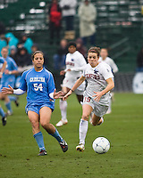 Stanford forward Kelley O'Hara (19) dribbles away from North Carolina forward Casey Nogueira (54). North Carolina defeated Stanford 1-0 to win the 2009 NCAA Women's College Cup at the Aggie Soccer Stadium in College Station, TX on December 6, 2009.