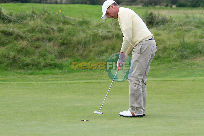 David Higgins sinks his putt on the 16th green during Day 3 of the 100th Irish PGA championship at Seapoint Golf Club, Co Louth...Picture Eoin Clarke/www.golffile.ie.