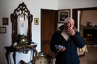 Undisclosed Location. 20.04.2014. Carmine Schiavone, a former head of the Casalesi clan (part of the Camorra criminal syndicate). Photographed in his home in Italy. Schiavone was a key witness in the Spartacus trial, which saw the heaviest penalties ever for organised crime with a total of 700 years of imprisonment. Over the course of the initial trial and the appeal, five people involved in the case were murdered, including a court interpreter. A judge and two journalists were threatened with death. In all, 115 people were prosecuted, 27 life sentences, plus 750 years in prison were handed out to the defendants. Schiavone died on february 22nd 2015. Photo: Christopher Olssøn.