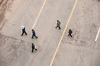 Orthographic View Of Construction Workers Walking Across A Road In Chongqing, China.  © LAN